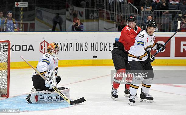Tomi Karhunen Mike Iggulden of Koeln and Ari Vallin of Oulu in action during the Champions Hockey League group stage game between Koelner Haie and...