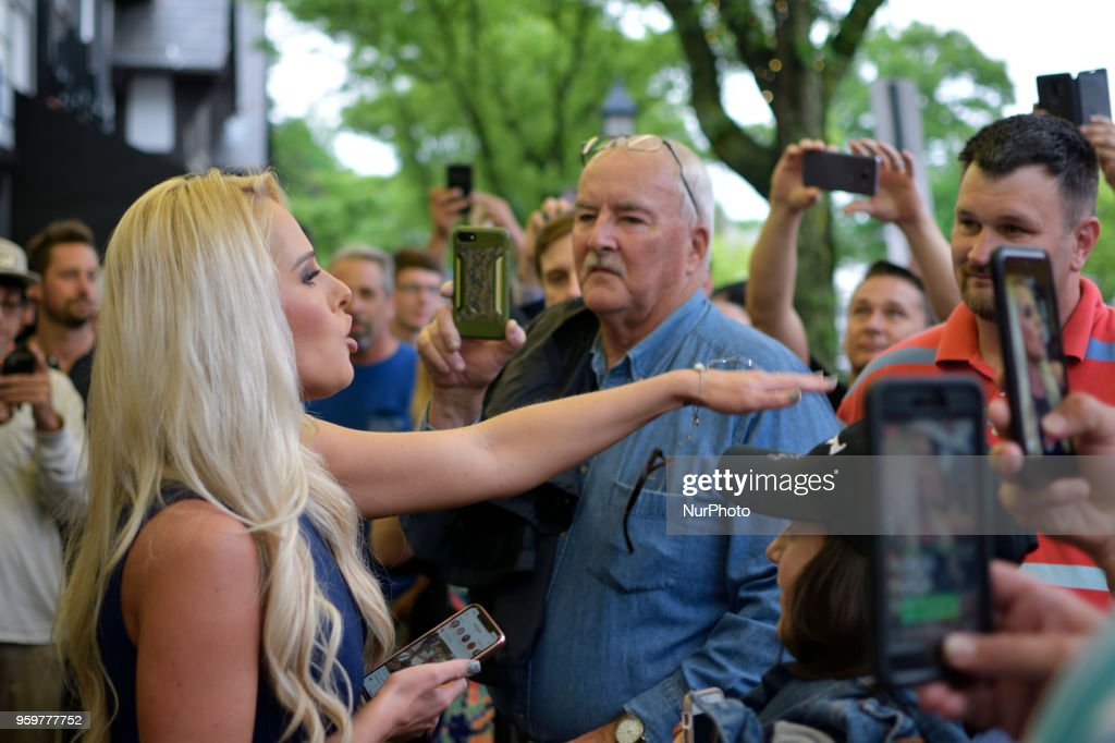 Tomi Lahren, conservative political commentator and Fox News contributor greets fans waiting in line outside the Keswick theatre in Glenside, PA on May 17, 2018. Across the street from the Philadelphia suburban theatre a group of demonstrators stage a protest to oppose Lahrens political views.