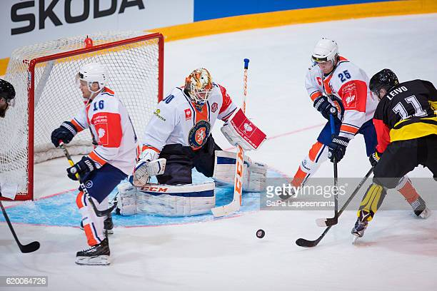 Tomi Leivo of Lappeenranta challenges Geoff Platt, Joacim Eriksson and Philip Holm of Vaxjo during the Champions Hockey League Round of 16 match...