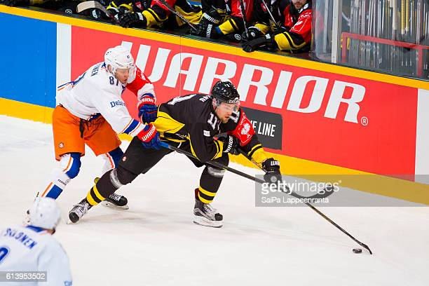 Tomi Leivo of Lappeenranta challenges Tomi Peltonen of Tampere during the Champions Hockey League Round of 32 match between SaiPa Lappeenranta and...