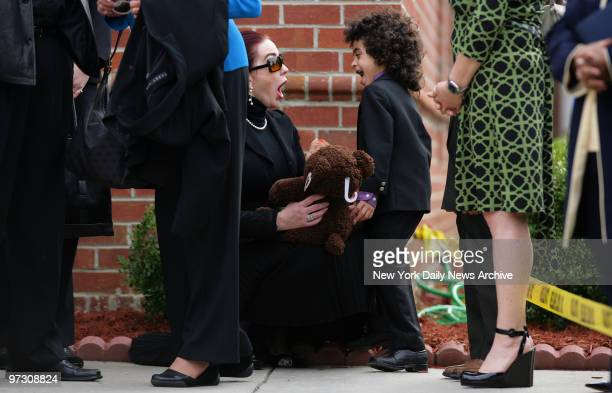 Tomi Rae Brown tries to cheer up her son James Brown 2d as they wait to attend a private service for soul legend James Brown at the Carpentersville...