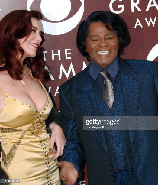 Tomi Rae Hynie and James Brown during The 47th Annual GRAMMY Awards - Arrivals at Staples Center in Los Angeles, California, United States.