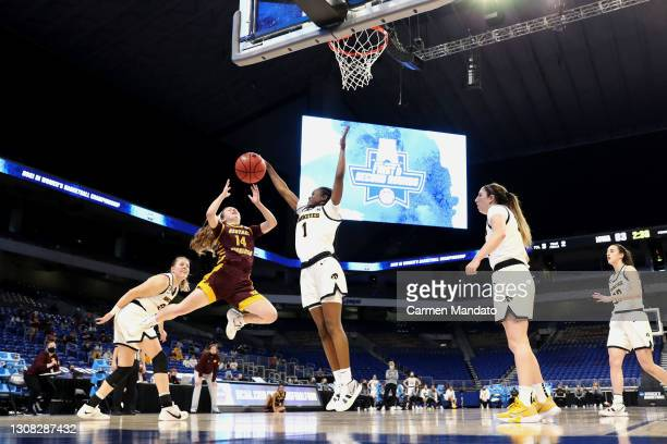 Tomi Taiwo of the Iowa Hawkeyes defends against Molly Davis of the Central Michigan Chippewas during the second half in the first round game of the...