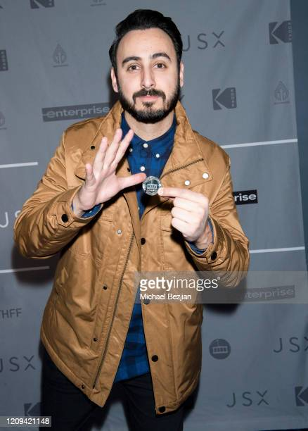 Tomik Mansoori arrives holding The Artists Project First Break Medallion at the 3rd Annual Mammoth Film Festival Red Carpet Friday on February 28...