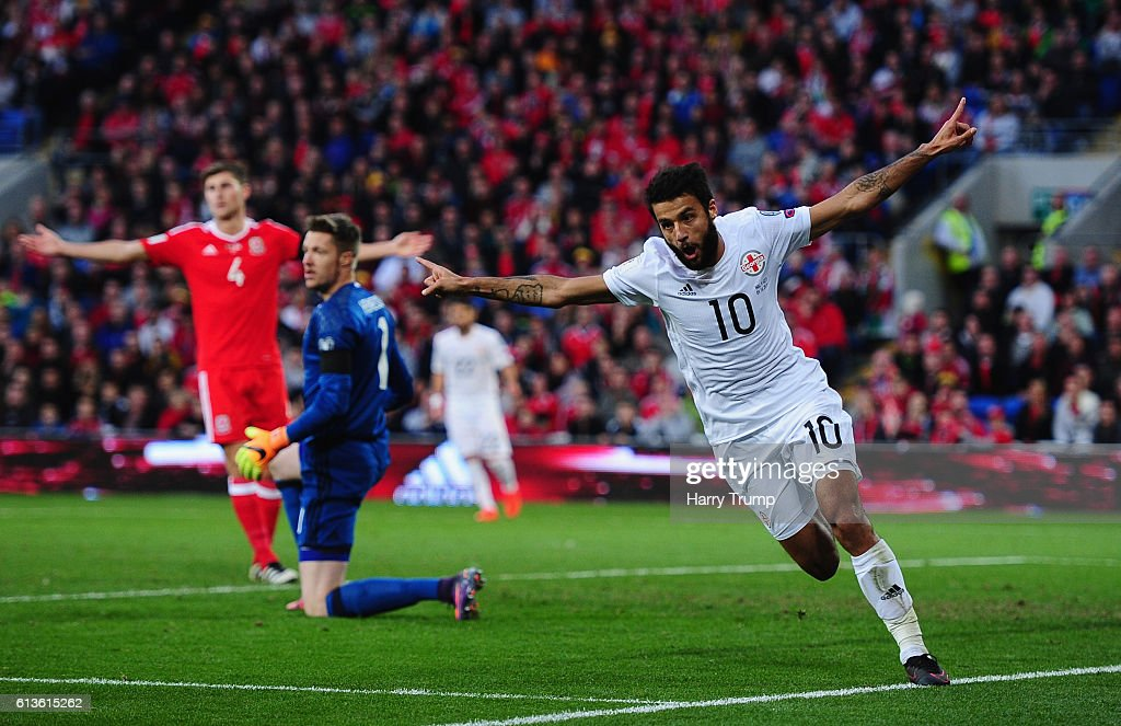 Tomike Okriashvili of Georgia celebrates his sides first goal during the 2018 FIFA World Cup Qualifier between Wales and Georgia at the Cardiff City Stadium on October 9, 2016 in Cardiff, Wales.