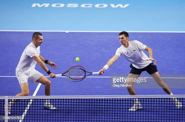 Tomislav Brkic of Bosnia and Herzegovina with his partner Nikola Cacic of Serbia plays a shot the men's doubles final match against Matwe Middelkoop...