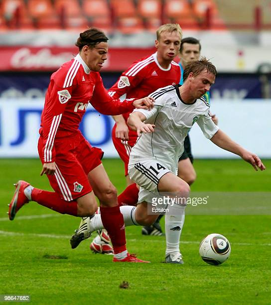 Tomislav Dujmovic of FC Lokomotiv Moscow battles for the ball with Sergei Kornilenko of FC Tom Tomsk during the Russian Football League Championship...