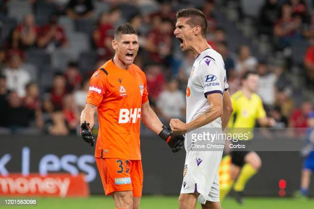 Tomislav Mrcela of the Glory reacts to winning the match with teammate Liam Reddy during the round 15 A-League match between the Western Sydney...