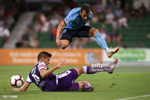 Tomislav Mrcela of the Glory tackles Adam Le Fondre of Sydney during the round 12 ALeague match between the Perth Glory and Sydney FC at HBF Park on...