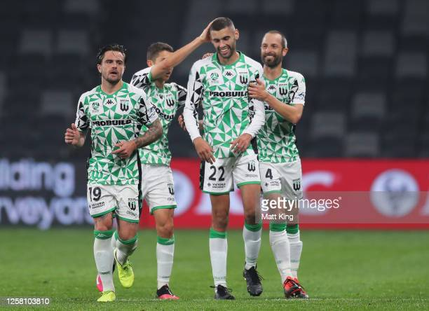 Tomislav Uskok of United celebrates with team mates after scoring a goal during the round 28 A-League match between Melbourne Victory and Western...