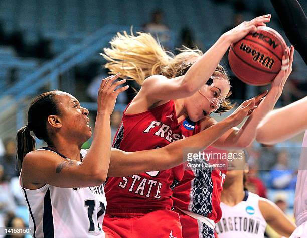 Tommacina McBride of the Georgetown Hoyas battles for a rebound with Bree Farley of the Fresno State Bulldogs during the second round of the 2012...