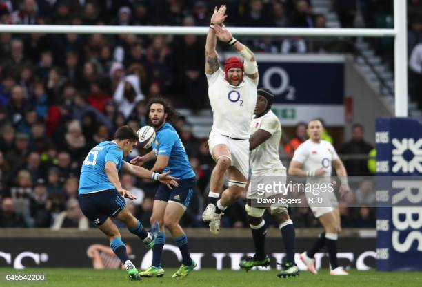 Tommaso Allan of Italy kicks a drop goal as James Haskell of England closes in during the RBS Six Nations match between England and Italy at...