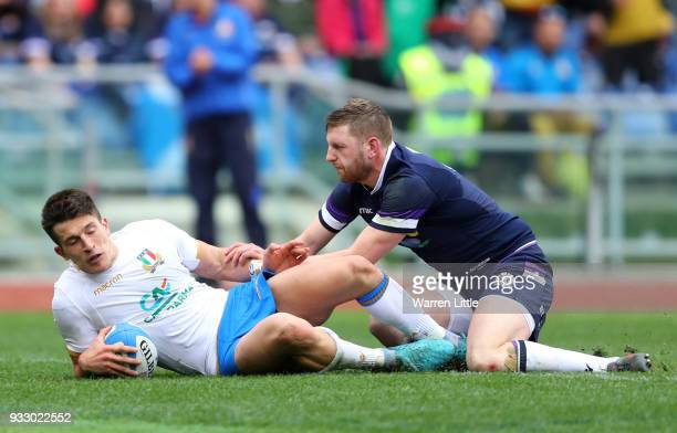 Tommaso Allan of Italy runs through to score his sides third try while under pressure from Finn Russell of Scotland during the NatWest Six Nations...
