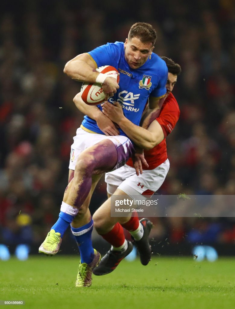Tommaso Benvenuti of Italy is tackled by Owen Watkin of Wales during the NatWest Six Nations match between Wales and Italy at Principality Stadium on March 11, 2018 in Cardiff, Wales.