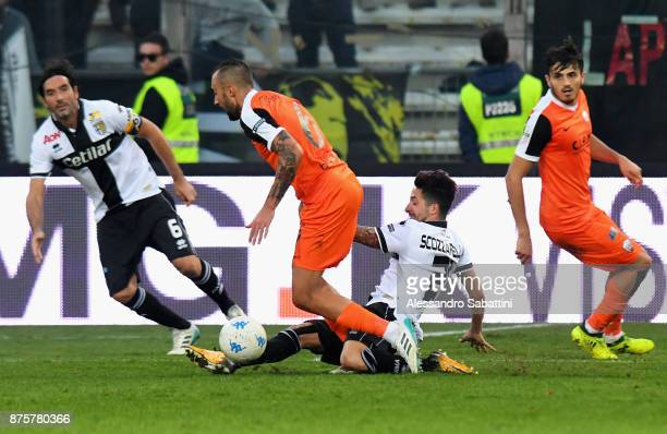 Tommaso Bianchi of Ascoli Picchio competes for the ball with Matteo Scozzarella of Parma Calcio during the Serie B match between Parma Calcio and...