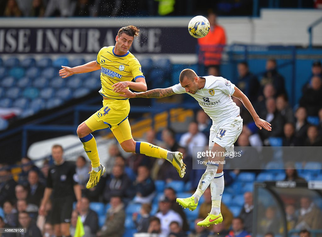 Tommaso Bianchi of Leeds United challenges Gary Madine of Sheffield Wednesday during the Sky Bet Championship match between Leeds United and Sheffield Wednesday at Elland Road on October 4, 2014 in Leeds, England.