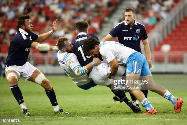 Tommaso Boni of Italy tackles Duncan Taylor of Scotland during the International Test match between Italy and Scotland at Singapore Sports Stadium on...