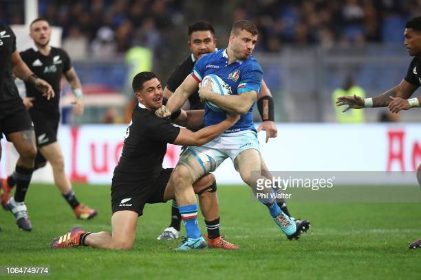Tommaso Castello of Italy is tackled by Anton LienertBrown of the All Blacks during the International Rugby match between the New Zealand All Blacks...