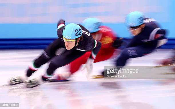 Tommaso Dotti of Italy competes in the Short Track Speed Skating Men's 1500m qualifying on day 3 of the Sochi 2014 Winter Olympics at Iceberg Skating...