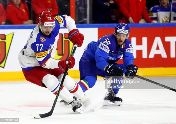Tommaso Goi of Italy challenges Artemi Panarin of Russia for the puck during the 2017 IIHF Ice Hockey World Championship game between Italy and...