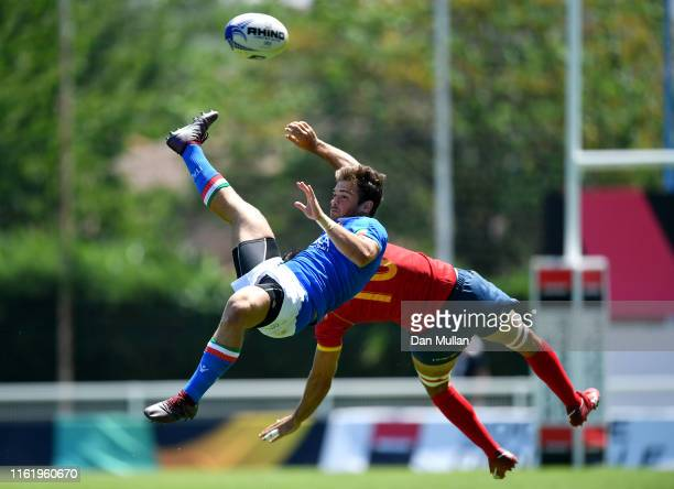 Tommaso Jannelli of Italy and Javier Mario Carrion Llorens of Spain collide in the air whilst challenging for the ball during the 5th place Semi...
