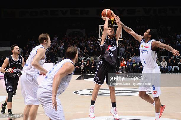 Tommaso Oxilia of Segafredo competes with Andrea La Torre and Tommaso Rinaldi and Jesse Perry of De Longhi during the LegaBasket Serie A2 LNP match...