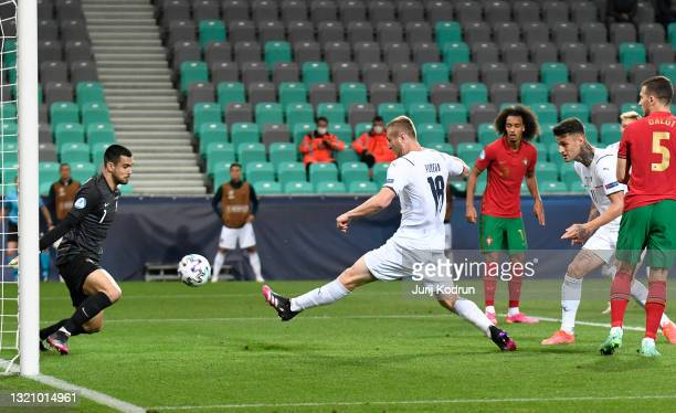 Tommaso Pobega of Italy scores their side's first goal past Diogo Costa of Portugal during the 2021 UEFA European Under-21 Championship...
