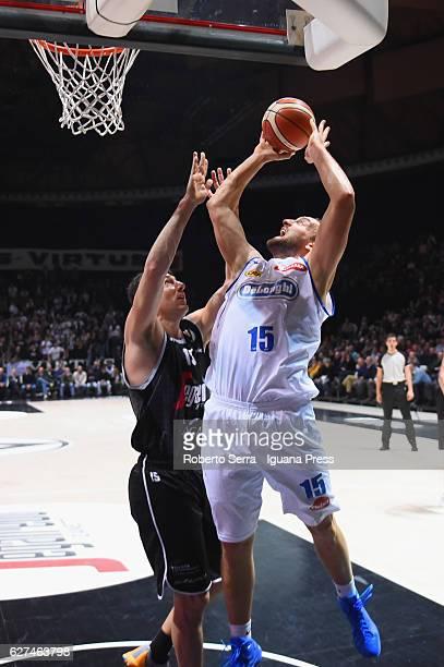 Tommaso Rinaldi of De Longhi competes with Andrea Michelori of Segafredo during the LegaBasket Serie A2 LNP match between Virtus Segafredo Bologna...