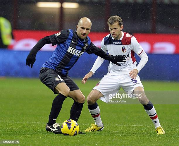 Tommaso Rocchi of FC Inter Milan and Mikael Antonsson of Bologna FC compete for the ball during the TIM cup match between FC Internazionale Milano...