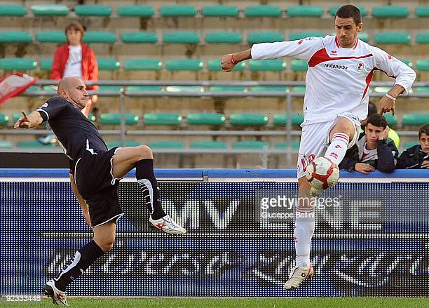 Tommaso Rocchi of SS Lazio and Leonardo Bonucci of AS Bari in action during the Serie A match between Bari and Lazio at Stadio San Nicola on October...