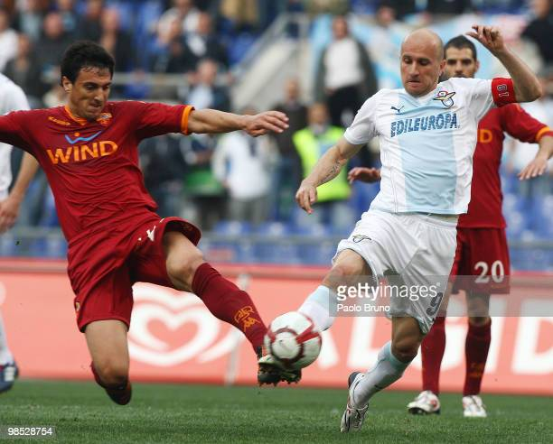 Tommaso Rocchi of SS Lazio and Nicolas Burdisso of AS Roma compete for the ball during the Serie A match between SS Lazio and AS Roma at Stadio...