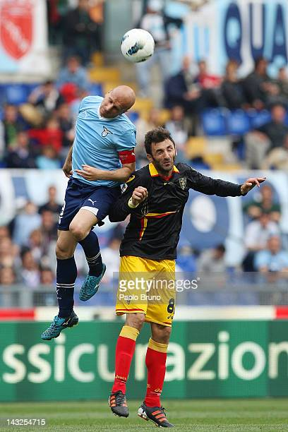 Tommaso Rocchi of SS Lazio competes for the ball in the air with Gennaro Del Vecchio of US Lecce during the Serie A match between SS Lazio and US...