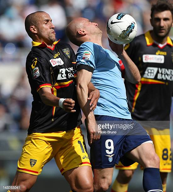 Tommaso Rocchi of SS Lazio competes for the ball with Guillermo Giacomazzi of US Lecce during the Serie A match between SS Lazio and US Lecce at...