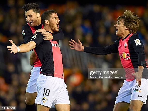 Tommer Hemed of Almeria celebrates after scoring with his teammate Ximo Navarro and Mauro Javier Dos Santos during the La Liga match between Valencia...