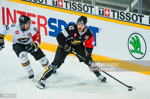 Tommi Jokinen of SaiPa and Ari Vallin of Karpat during the Champions Hockey League quarter final first leg game between SaiPa Lappeenranta and Karpat...
