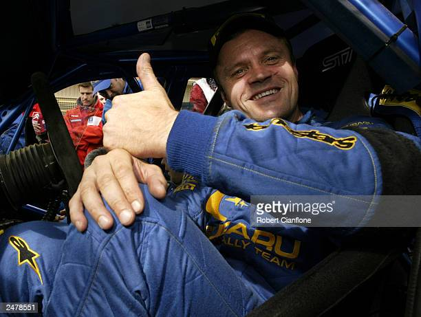 Tommi Makinen of Finland and the Subaru World Rally Team acknowledges the media at the service park during the 2003 Rally Australia which is round 10...