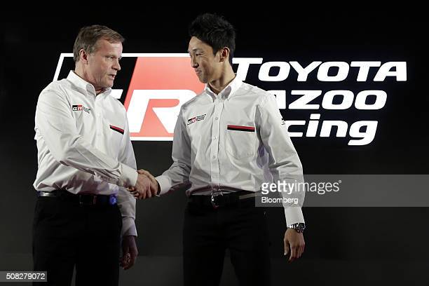 Tommi Makinen team principal of the Toyota Motor Corp Gazoo Racing team competing in the FIA World Rally Championship left shakes hands with racing...