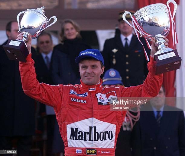Tommi Makinen with Mitsubishi Lancer Evo VI celebrates victory during the World Rally Championships in Monte Carlo Monaco Germano Gritti / Grazia...