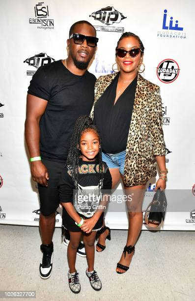 Tommicus Walker and LeToya Luckett pose with their daughter backstage at 2018 LudaDay Celebrity Basketball Game at Morehouse College Forbes Arena on...