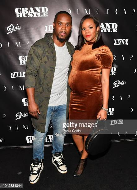 Tommicus Walker and singer/actress LeToya Luckett attend TI's Dime Trap Private Album Release Party at The Trap Museum on October 4 2018 in Atlanta...