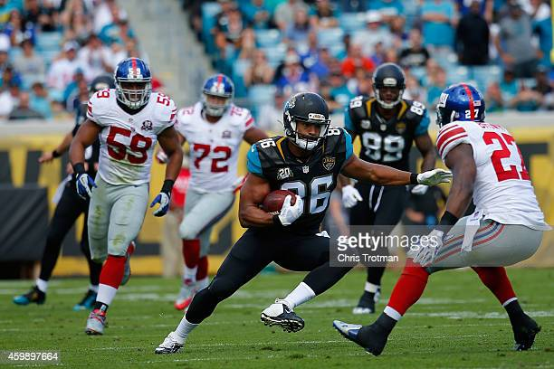 Tommie Campbell of the Jacksonville Jaguars runs with the ball against the New York Giants at EverBank Field on November 30 2014 in Jacksonville...