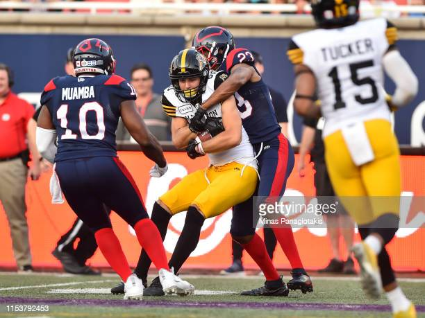 Tommie Campbell of the Montreal Alouettes grabs a hold of Jaelon Acklin of the Hamilton TigerCats in the first half during the CFL game at Percival...