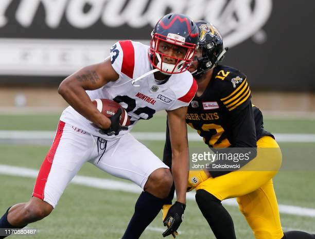 Tommie Campbell of the Montreal Alouettes intercepts a pass against Mike Jones of the Hamilton TigerCats at Tim Hortons Field on June 28 2019 in...