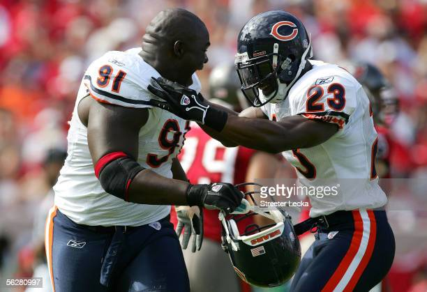 Tommie Harris of the Chicago Bears celebrates with teammate Jerry Azumah after recovering a fumble against the Tampa Bay Buccaneers during their game...