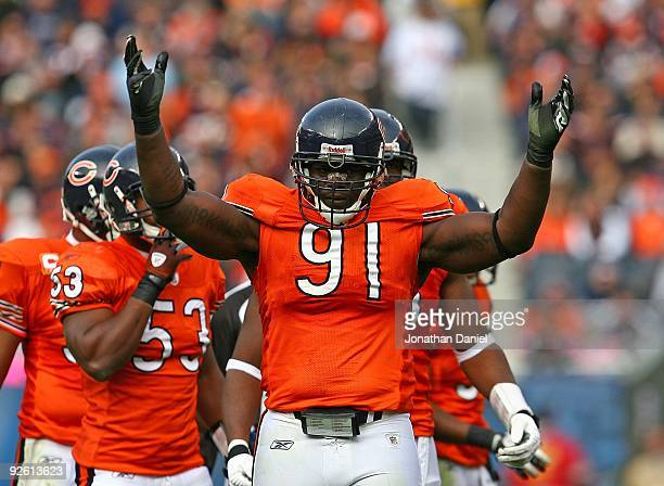 Tommie Harris of the Chicago Bears encourages the crowd during a game against the Cleveland Browns at Soldier Field on November 1 2009 in Chicago...
