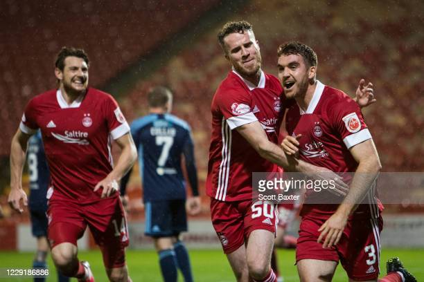 Tommie Hoban of Aberdeen celebrates with Marley Watkins during the Ladbrokes Premiership match between Aberdeen and Hamilton at Pittodrie Stadium on...