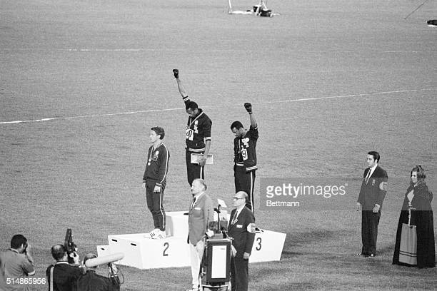 Tommie Smith and John Carlos, gold and bronze medalists in the 200-meter run at the 1968 Olympic Games, engage in a victory stand protest against...