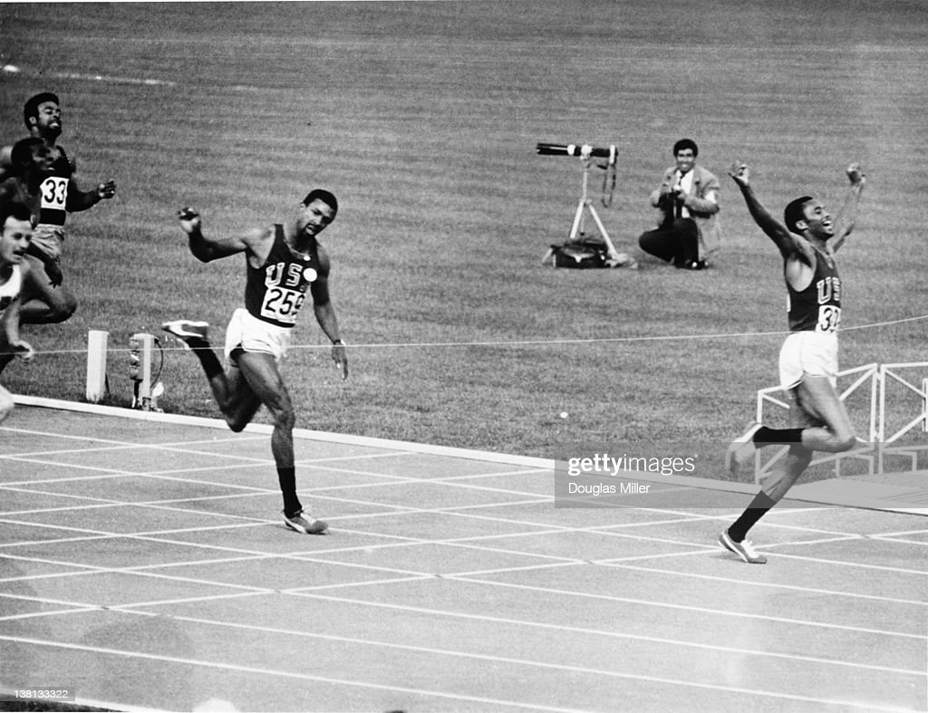 Tommie Smith (right) of the USA wins the men's 200 metres final at the Olympic Games in Mexico City, 16th October 1968. Bronze medallist John Carlos, also of the USA is on the left. Smith and Carlos later caused controvery when they gave the black power salute on the medal podium.