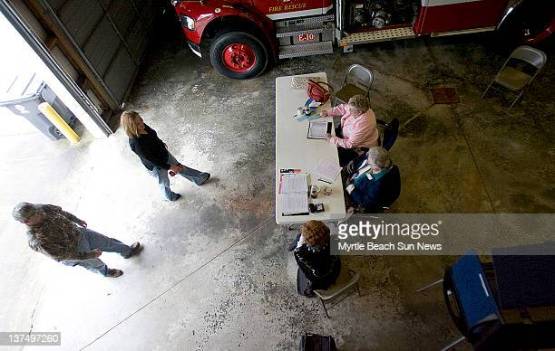 Tommy and Jana Collins enter the Horry County Fire and Rescue Station Number 10 in Horry County South Carolina to vote in the South Carolina...