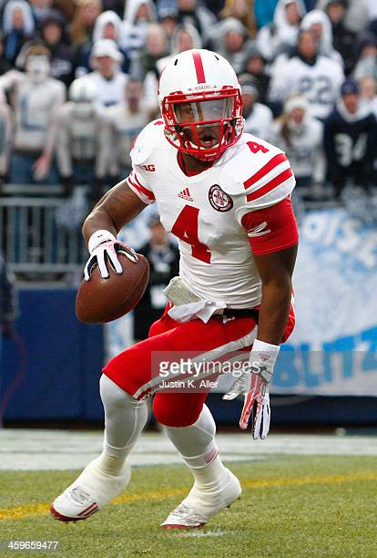 Tommy Armstrong Jr #4 of the Nebraska Cornhuskers rolls out to pass against the Penn State Nittany Lions during the game on November 23 2013 at...